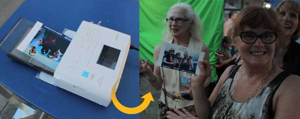 happy lady smiling with her printed photo from green screen photo booth